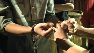 Man being handcuffed