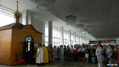 Wooden church inside a railway station in Russia