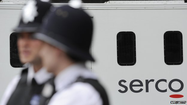 police officers and a Serco van