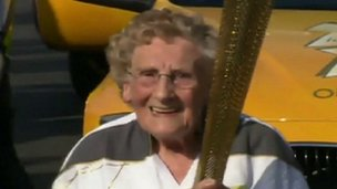 Jean Bishop holding the Olympic torch