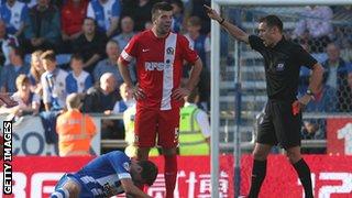 Blackburn's Grant Hanley is sent off at Wigan on Sunday