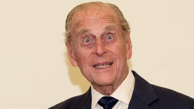 The Duke of Edinburgh gestures after watching a display by pupils of the Broadland School of Dance in the ACT centre of the St Michaels Care Complex in Aylsham, Norfolk,