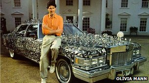 Uri Geller with a car covered in spoons