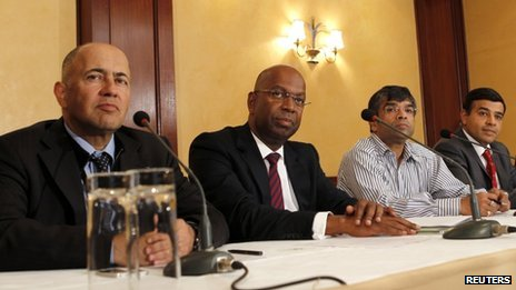 Representatives of mobile phone companies at a joint news conference in Nairobi on 8 October 2013