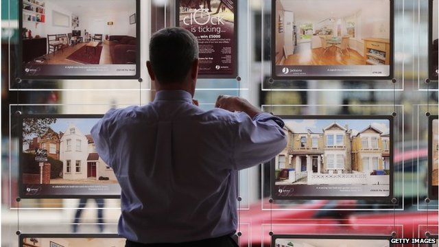 Estate agent puts advert in window