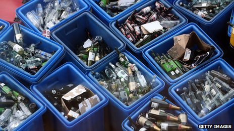 Bottles in recycling bins
