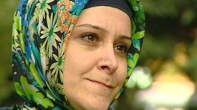 Ayse, a qualified English teacher wearing a headscarf