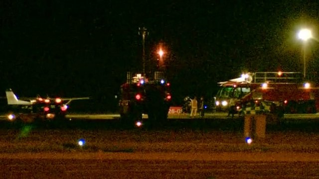 Emergency services and the aircraft on the runway at Humberside Airport
