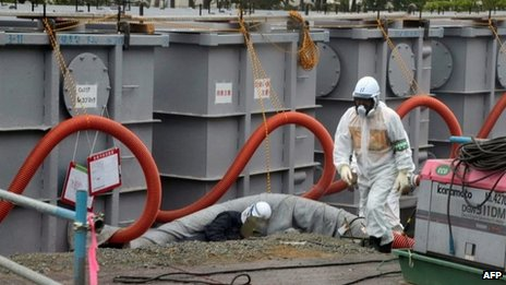 Tokyo Electric Power Co (Tepco) workers work on waste water tanks at Japan's Fukushima Dai-ichi nuclear plant in the town of Okuma, Fukushima prefecture in Japan on 12 June 2013