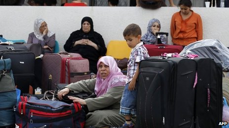 Palestinians wait by the Rafah border terminal in Gaza (August 2013)