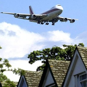 Aircraft flying over houses
