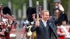 Sir Chris Hoy carrying the Commonwealth baton