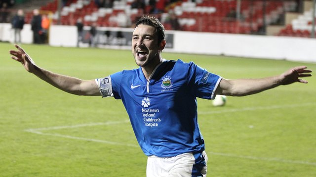 Michael Gault celebrates scoring the winning penalty in the shoot-out which gave Linfield victory over Glentoran in the League Cup at The Oval