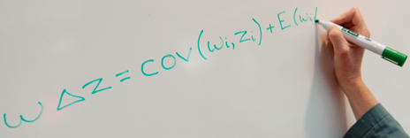 Price equation written on whiteboard