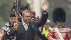 Sir Chris Hoy carries the baton