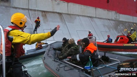 Boats from Greenpeace approach a Russian oil rig as officials try to stop them