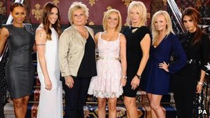 Jennifer Saunders (third left) and Judy Craymer (third right) with the Spice Girls (from left to right) Melanie Brown (Mel B), Melanie Chisholm (Mel C), Geri Halliwell, Emma Bunton and Victoria Beckham