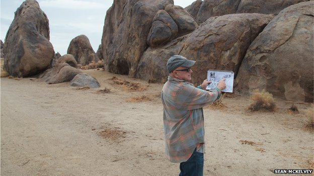 Langley looks at a photograph in Alabama Hills