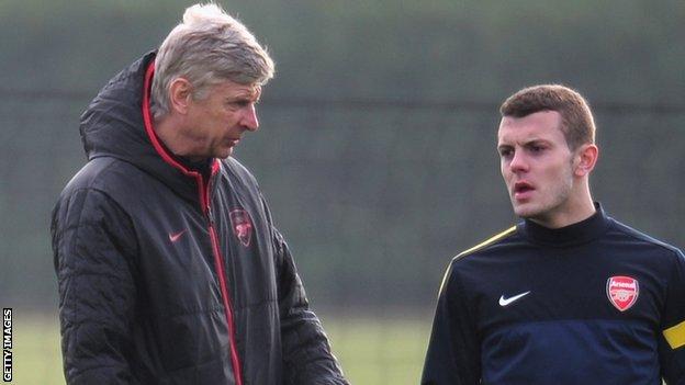 Arsenal manager Arsene Wenger and midfielder Jack Wilshere