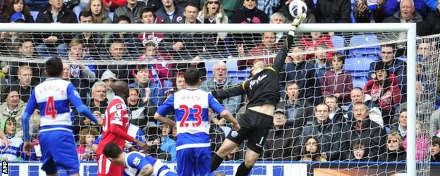 Goalkeeper Robert Green makes a save for QPR