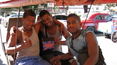 A young Cuban and his friends show off a bag emblazoned with the Union Jack