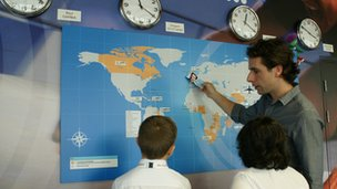Mark Beaumont shows students Commonwealth Queen's baton relay route