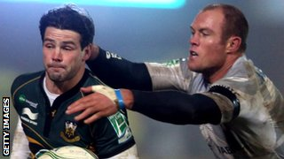 Ben Foden and Jannie Bornman in action