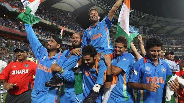 Sachin Tendulkar celebrates with the India team