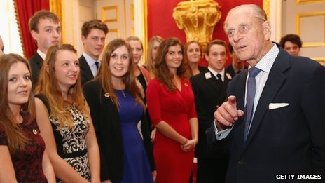 "The Duke of Edinburgh speaks with a group of young people during a reception to celebrate the 500th anniversary of his ""Duke of Edinburgh Award"""