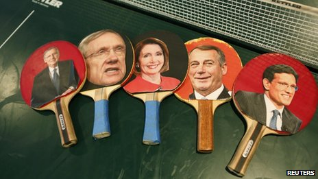 Table tennis paddles bear the pictures of key congressional leaders