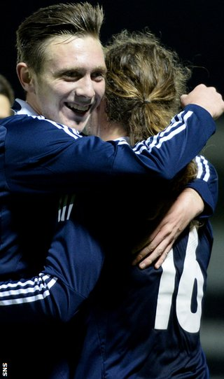 Scotland's Jordan McGhee (left) congratulates Stevie May