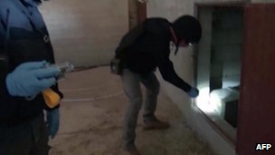 OPCW inspectors at a site in Syria in an image taken from Syrian television on 10 October 2013