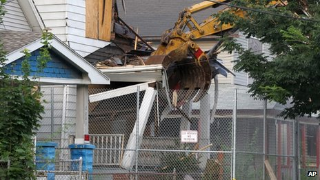The home of Ariel Castro being bulldozed in Cleveland on 7 August 2013.