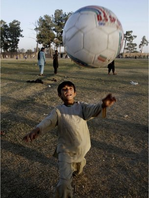 Afghan boy kicks football 1 October