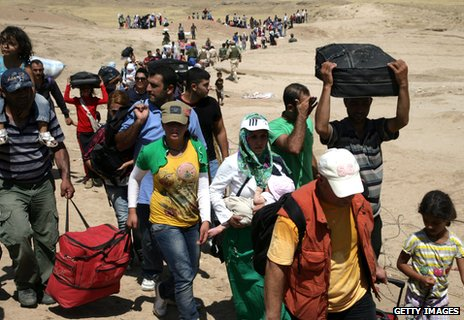 Syrian refugees crossing into northern Iraq