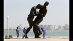 A statue of a head-butt by Algerian artist Adel Abdessemed in Doha, Qatar - Friday 4 October 2013