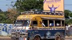 A bus passing a Youssou Ndour concert poster, Dakar, Senegal - Wednesday 9 October 2013