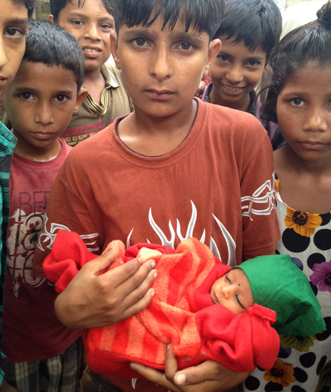 A young boy holds the baby in Muzaffarnagar