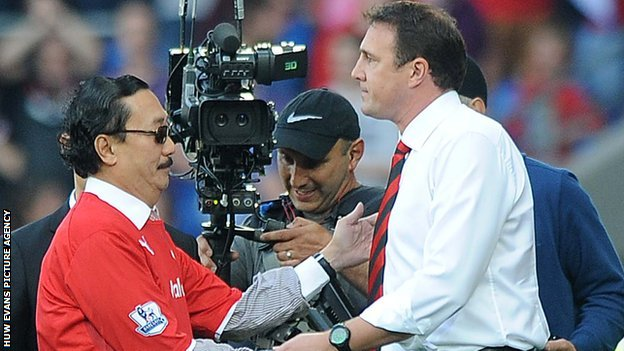 Tan Sri Vincent Tan and Malky Mackay