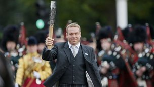 Chris Hoy with Commonwealth Games Baton