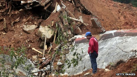 A rescuer surveys the mudslide near La Pintada