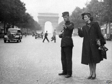 A policeman directs traffic on the Champs Elysees