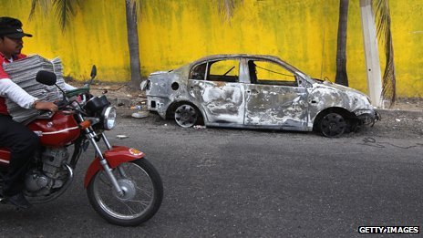 A burnt-out car in Acapulco