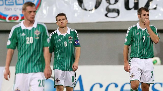 Northern Ireland players cannot hide their disappointment after the 2-0 defeat by Azerbaijan