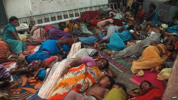 Indian residents rest in a cyclone shelter near Gopalpur, about 190 kms from the eastern city Bhubaneswar on October 11, 2013