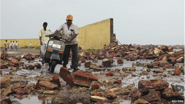 Debris from storm damage at a fishing harbour in Visakhapatnam district, Andhra Pradesh, India, 12 October 2013