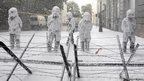 Belgian riot police in central Brussels are seen covered with foam