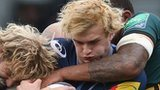 Castres' Scottish lock Richie Gray is tackle by Northampton's Courtney Lawes