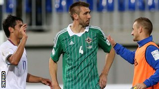 Gareth McAuley looks dejected after the 2-0 defeat by Azerbaijan
