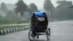 A rickshaw man bikes through heavy rain in Berhampur, about 180 kilometres south from eastern city Bhubaneswar